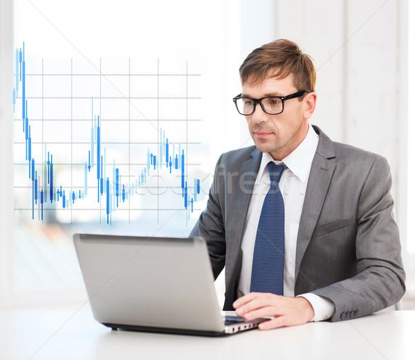 üzletember laptop számítógép forex diagram technológia pénz Stock fotó © dolgachov