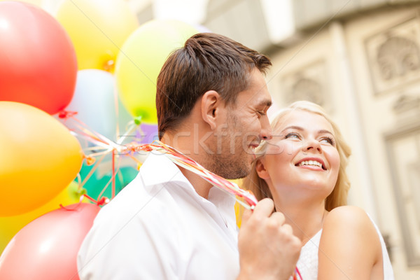 happy couple with colorful balloons Stock photo © dolgachov
