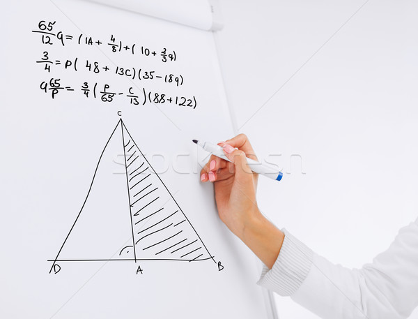 student or teacher sloving task on flip board Stock photo © dolgachov