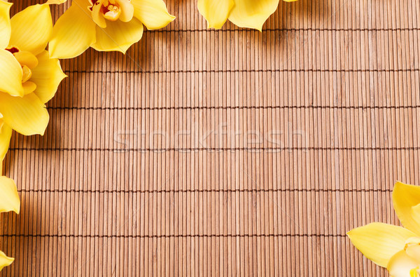 closeup of orchid flowers on bamboo mat Stock photo © dolgachov