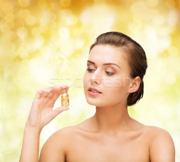 Piękna kobieta butelki złoty pyłu piękna Zdjęcia stock © dolgachov