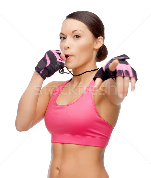 asian personal trainer with whistle Stock photo © dolgachov
