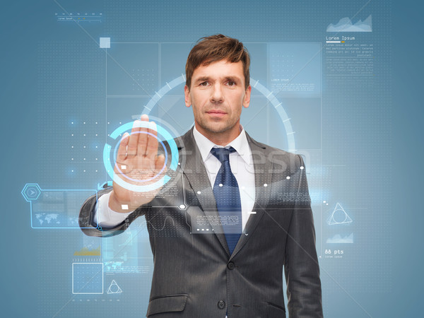 attractive buisnessman wotking with virtual screen Stock photo © dolgachov