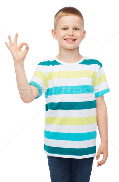 little boy in casual clothes showing OK gesture Stock photo © dolgachov