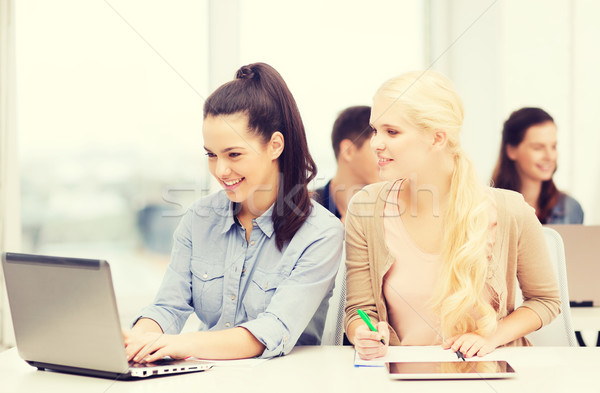 students with laptop, tablet pc and notebooks Stock photo © dolgachov