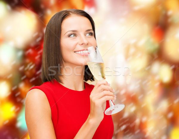 Mujer vestido rojo vidrio champán fiesta bebidas Foto stock © dolgachov