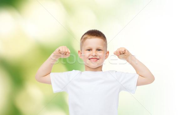 счастливым мало мальчика белый футболки бицепс Сток-фото © dolgachov