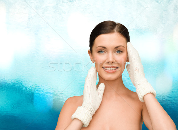 smiling young woman in white mittens Stock photo © dolgachov