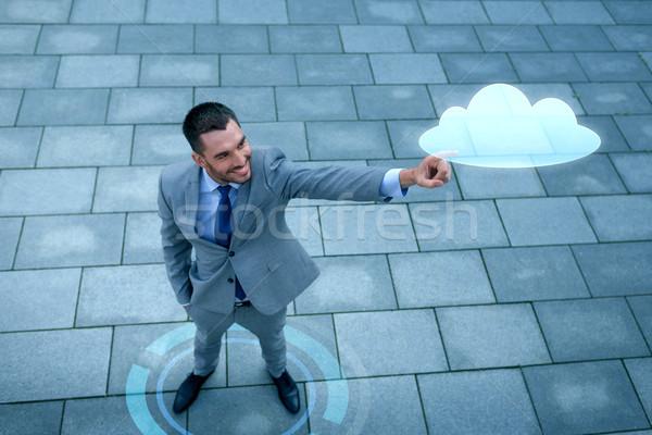 Sorridente empresário nuvem projeção ao ar livre negócio Foto stock © dolgachov