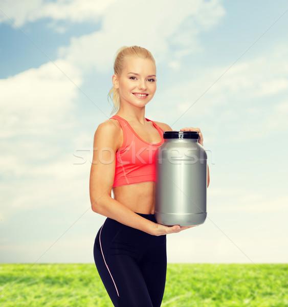 Souriant femme jar protéines fitness Photo stock © dolgachov