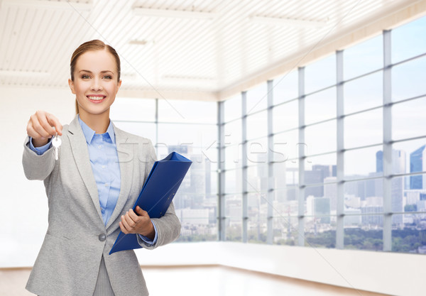 smiling businesswoman with folder and keys Stock photo © dolgachov