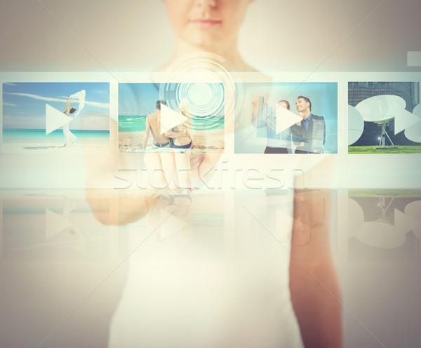 woman pressing button on virtual screen Stock photo © dolgachov