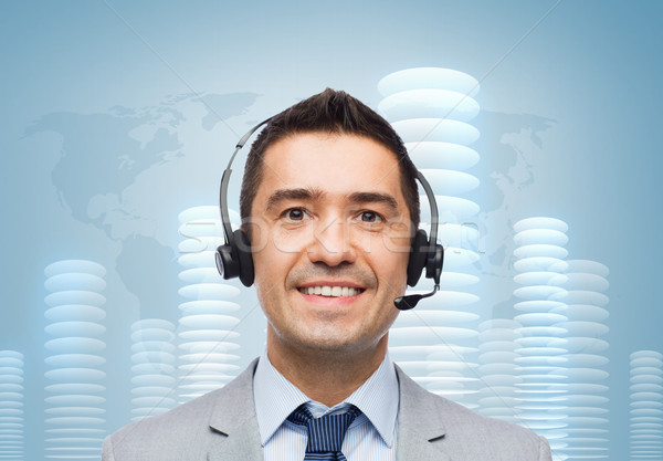 smiling businessman in headset over bit coin Stock photo © dolgachov