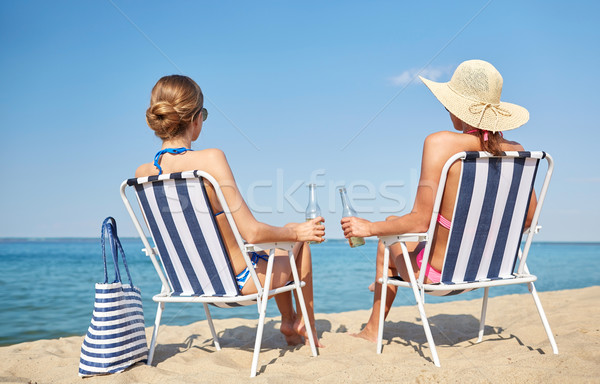 Mutlu kadın güneşlenme plaj yaz tatili seyahat Stok fotoğraf © dolgachov
