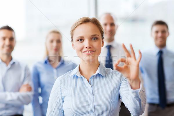 笑みを浮かべて 女性実業家 にログイン オフィス ストックフォト © dolgachov