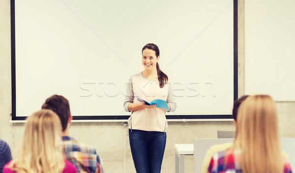 Grupo sorridente estudantes sala de aula educação escola secundária Foto stock © dolgachov
