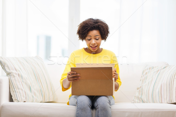 happy african young woman with parcel box at home Stock photo © dolgachov