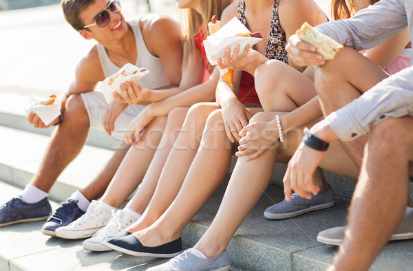 happy friends eating takeout fast food in city  Stock photo © dolgachov