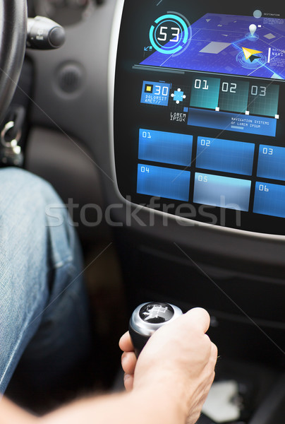 hand on gearshift and car navigation system Stock photo © dolgachov