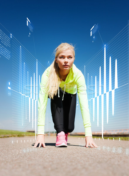 concentrated woman doing running outdoors Stock photo © dolgachov