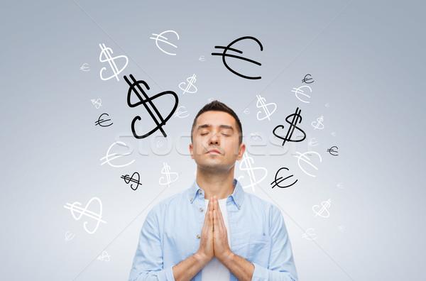 Boldog férfi imádkozik Isten pénz pénzügy Stock fotó © dolgachov
