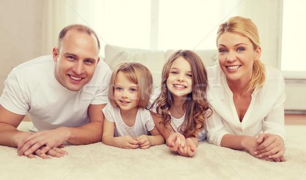Ouders twee meisjes vloer home familie Stockfoto © dolgachov