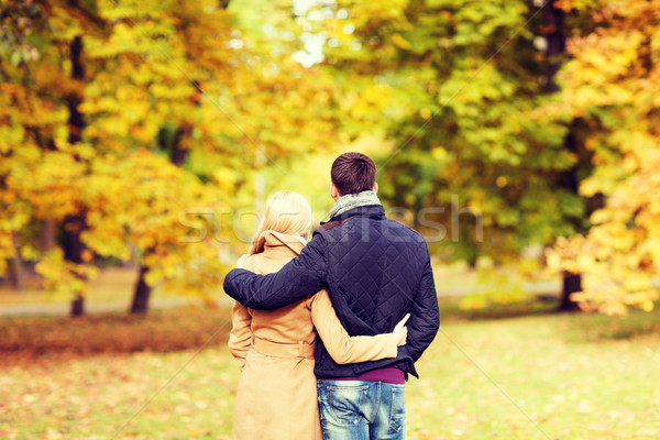 couple hugging in autumn park from back Stock photo © dolgachov