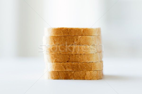 close up of white sliced toast bread pile on table Stock photo © dolgachov