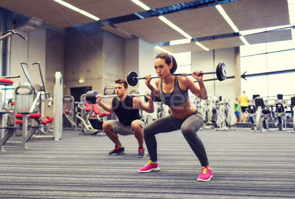 Jonge man vrouw opleiding barbell gymnasium sport Stockfoto © dolgachov