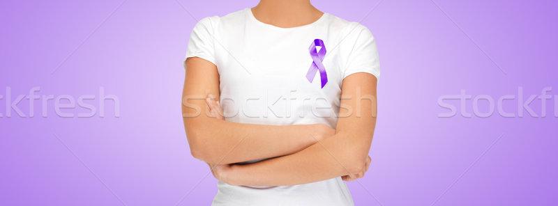 close up of woman with purple awareness ribbon Stock photo © dolgachov