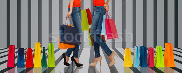 close up of women with shopping bags Stock photo © dolgachov