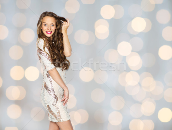 happy young woman or teen in dress over lights Stock photo © dolgachov