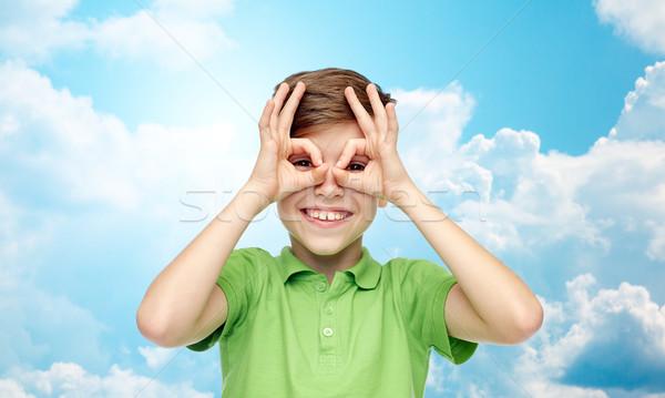happy boy in t-shirt having fun and making faces Stock photo © dolgachov