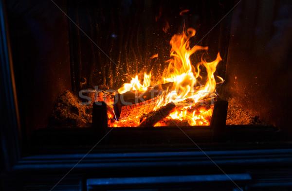 close up of burning fireplace at home Stock photo © dolgachov