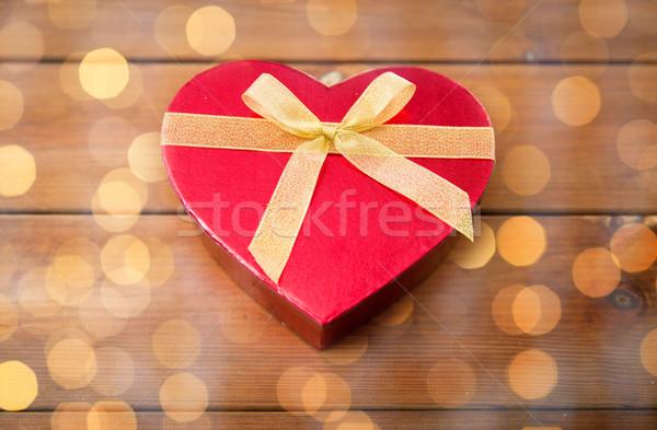 close up of heart shaped gift box on wood Stock photo © dolgachov