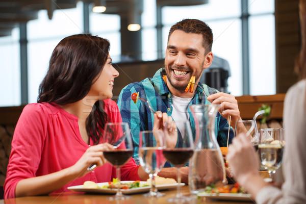 Foto stock: Feliz · Pareja · amigos · comer · restaurante · ocio