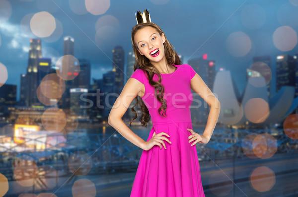 Heureux jeune femme adolescente rose robe personnes Photo stock © dolgachov