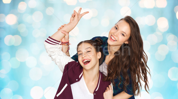 happy pretty teenage girls showing peace hand sign Stock photo © dolgachov