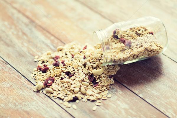 close up of jar with granola or muesli on table Stock photo © dolgachov