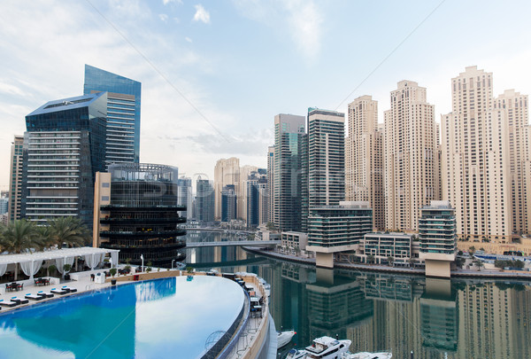 Dubai city seafront with hotel infinity edge pool Stock photo © dolgachov