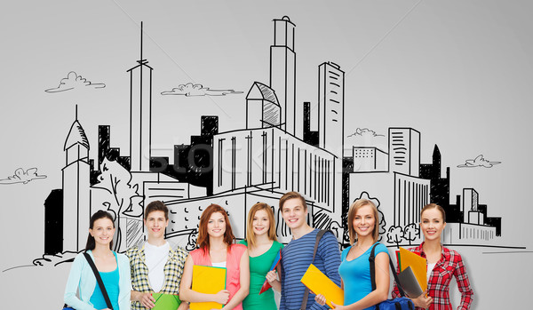 Groep studenten mappen zakken onderwijs Stockfoto © dolgachov