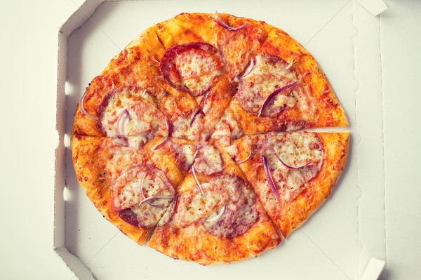 close up of pizza in paper box on table Stock photo © dolgachov