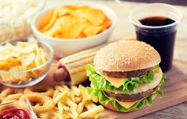 Stock fotó: Közelkép · gyorsételek · harapnivalók · ital · asztal · egészségtelen · étkezés