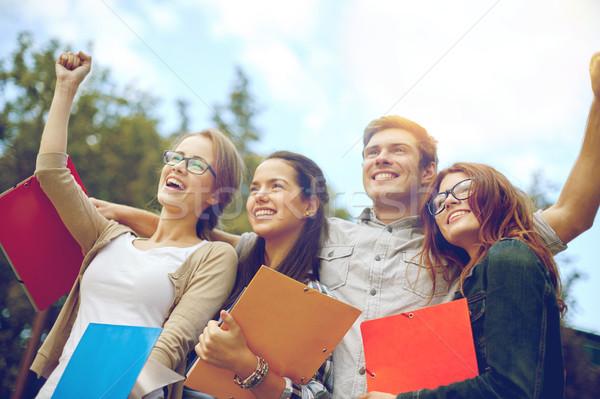 Groupe heureux élèves triomphe geste Photo stock © dolgachov
