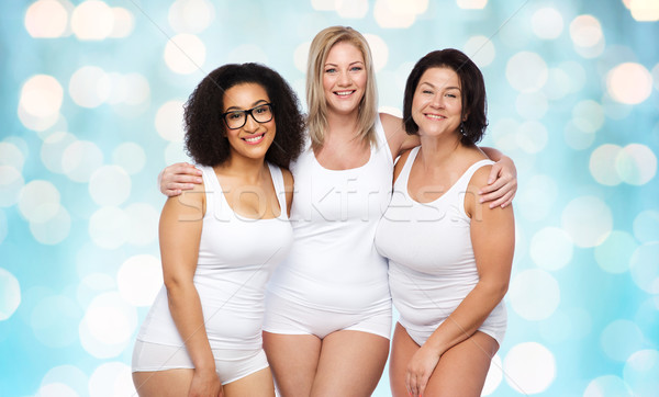 Stock photo: group of happy plus size women in white underwear