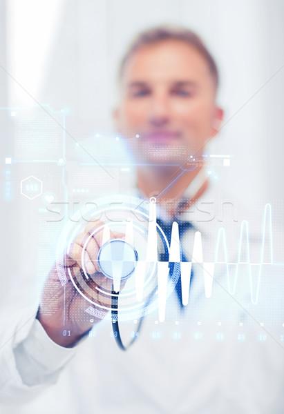 Férfi orvos sztetoszkóp kardiogram egészségügy gyógyszer férfi Stock fotó © dolgachov