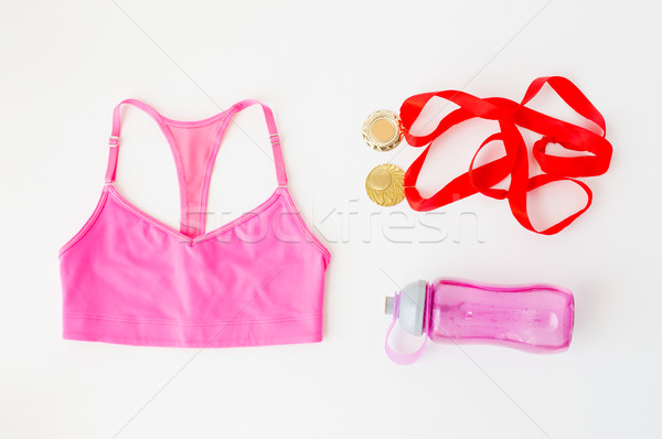 close up of sports top, golden medals and bottle Stock photo © dolgachov