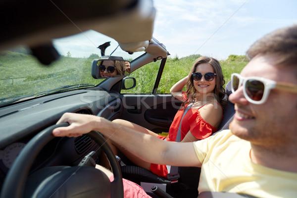 Szczęśliwy para jazdy kabriolet samochodu kraju Zdjęcia stock © dolgachov