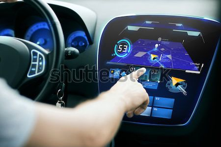 close up of man driving car with weather sensor Stock photo © dolgachov