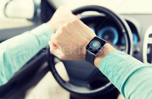 Stock photo: hands with starter icon on smartwatch driving car